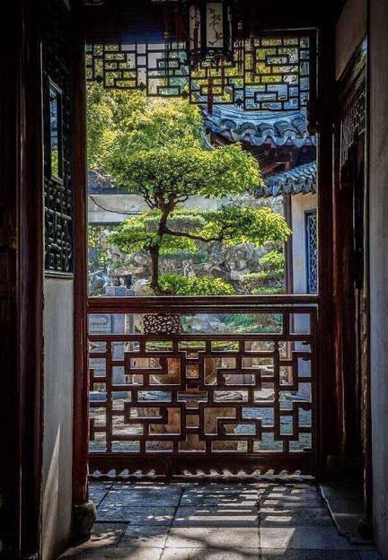 A corner of Suzhou-style residential garden: a view to garden through veranda