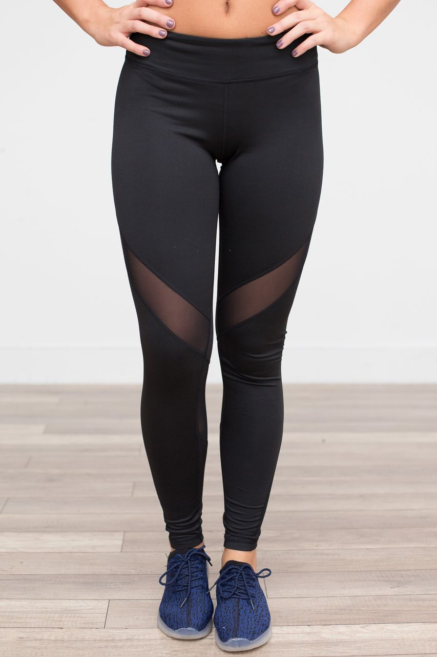 3293164fad Mesh work out leggings featuring a hidden pocket along the waistline.  Polyester/Spandex.