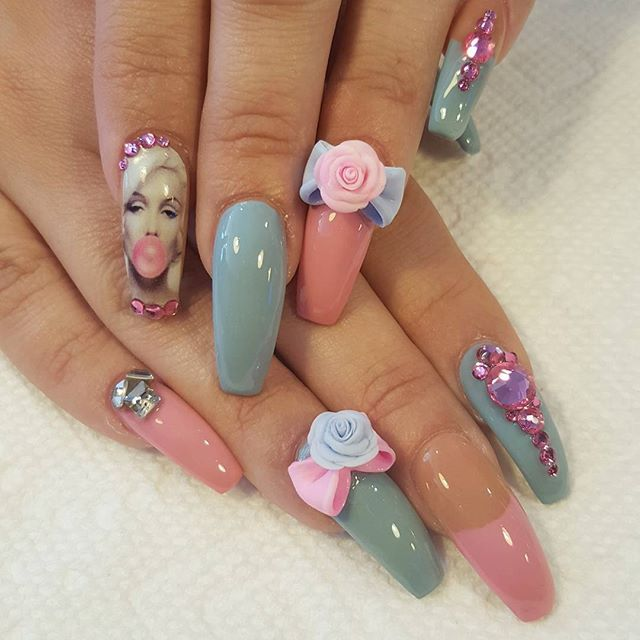 Not too much into the Marilyn Monroe nail but love the concept ...