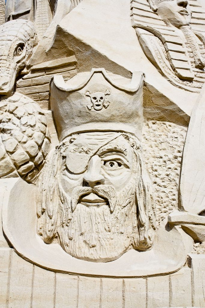 Look out for pirates! See great sand sculptures like this one at the Brevard County Art of Sand Festival in Cape Canaveral, Florida. #sandcastle #travel #sandsculpture