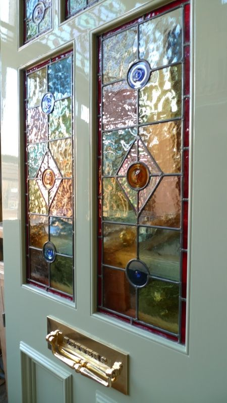 A Victorian Style Stained Glass Front Door Incorporating 3 Over 2 Glazed Panels