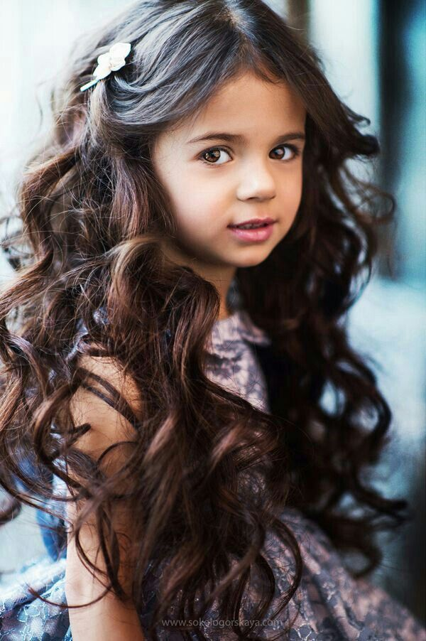 Maya   Zara's 6yr old daughter  Long dark curly hair  Holding Out