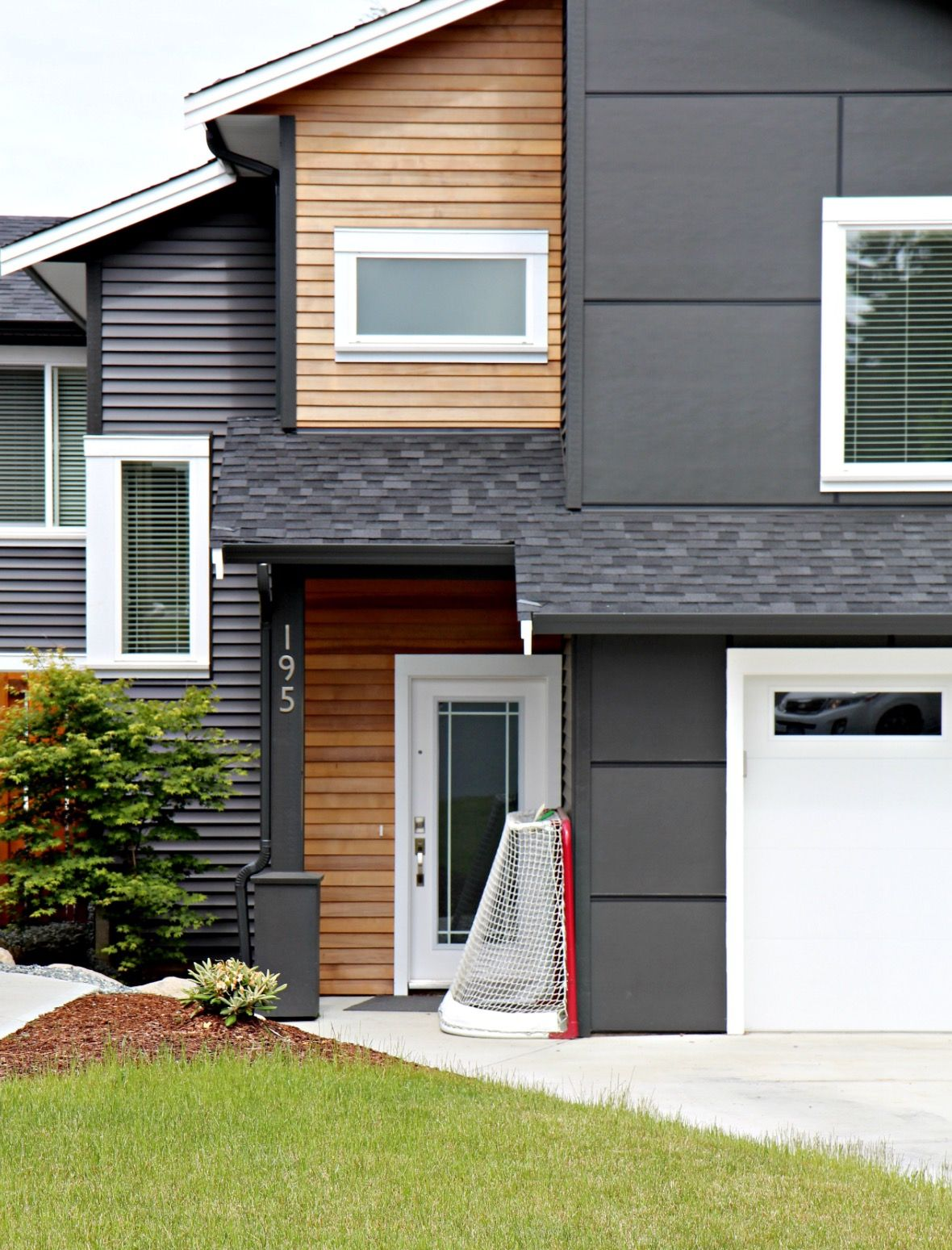 Gray siding with cedar pop out | House exterior, Modern ... on Modern House Siding  id=26942