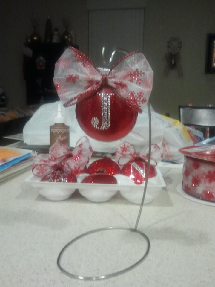 Another Pinterest inspired craft. So easy and so cute!   Supplies:  Clear ornaments, fine glitter, Pledge with future finish floor wax, ribbon, and rhinestone embellishment.