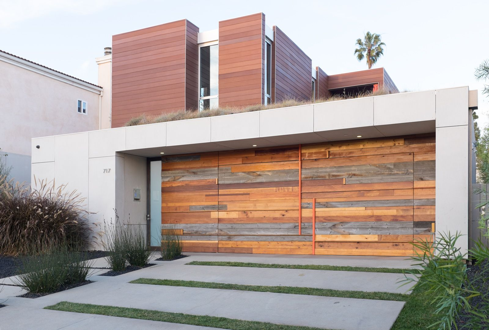 A Unique And Modern Garage Door Made From New And Reclaimed Wood