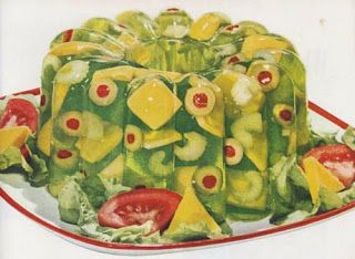 Jello mold with celery, cheese and olives. A traditional