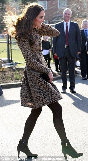 February 21, 2012 - The Duchess has a little bit of trouble with the wind blowing her dress