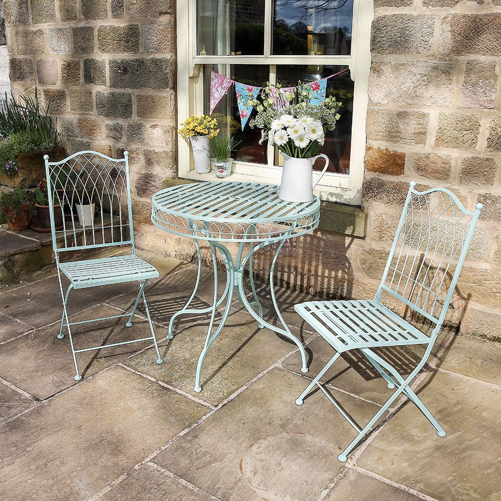 A Timeless Set Of Beautifully Designed Garden Furniture Consisting Round Table And Two Chairs Made From Wrought Iron Finished In Summer Blue