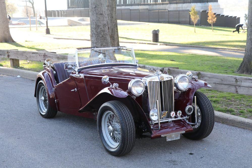 1949 MGTC Burgundy with burgundy leather interior. 54.5bhp