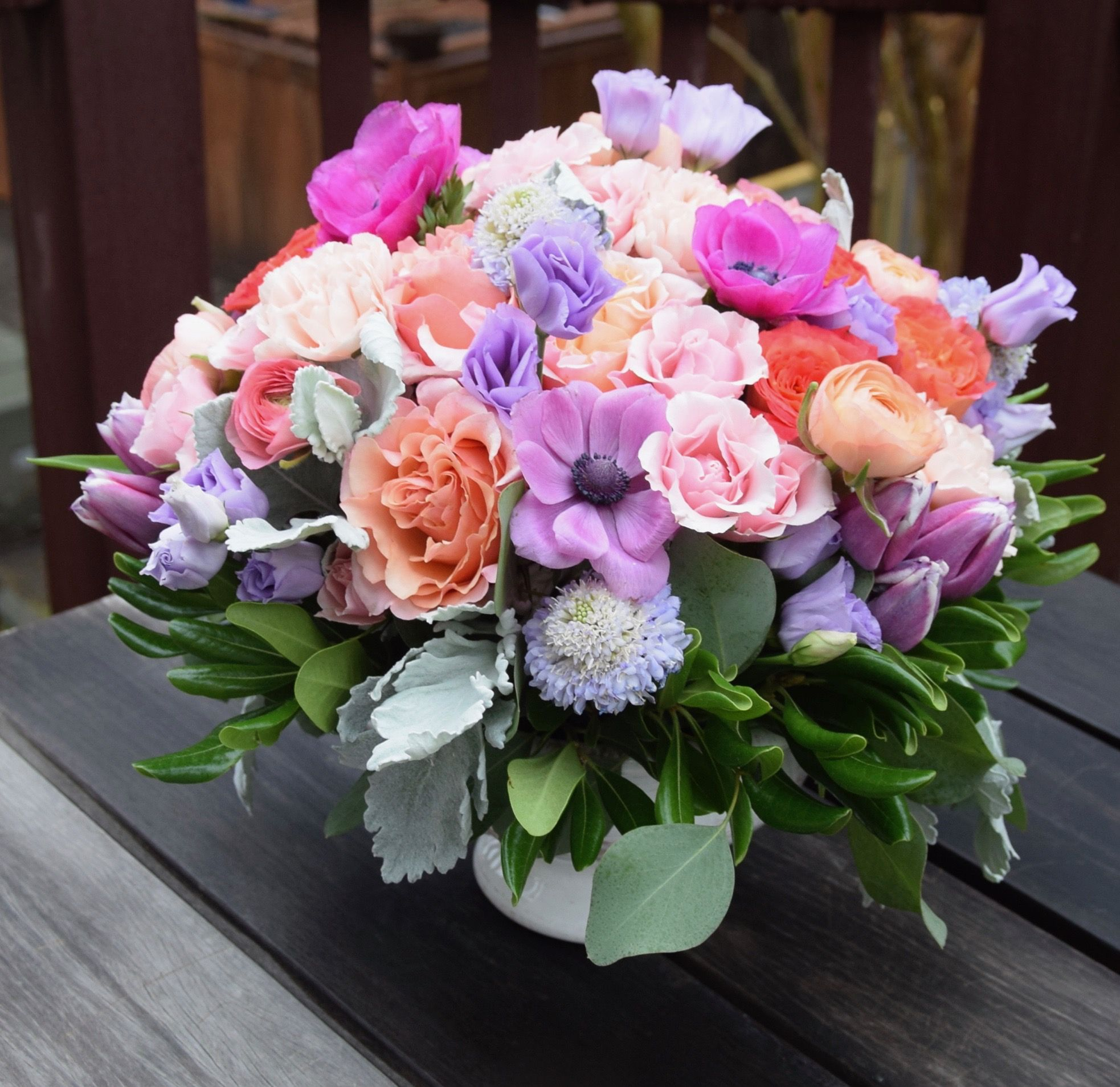 Flower Centerpiece With Pastel Color Tones Anemones Lisianthus Spray Roses Ranunculus Scabiosa Ru Flower Arrangements Flower Centerpieces Flower Delivery