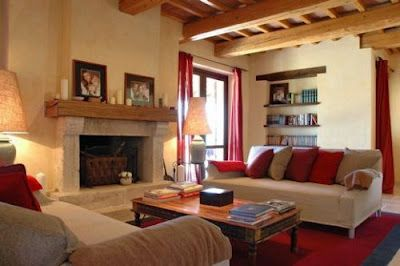 Love The Red And Tan Colors In This Living Room With Exposed Wood Beam Ceiling