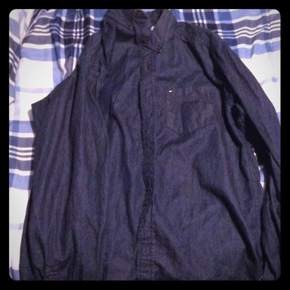Tommy Hilfiger long sleeve button down. Jean-like long sleeve button down. It is a child's XL which translates to an adult small. Tommy Hilfiger Tops Button Down Shirts