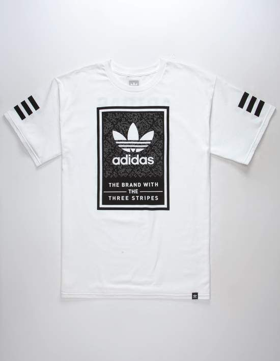 604d43ba Chain link fence print Adidas logo graphic screened on front with Adidas 03  screened on back. Adidas tag at hem. Short sleeves with screened 3 Stripes.