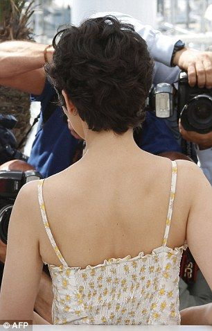 Audrey Tautou keeps it low key in pretty floral dr