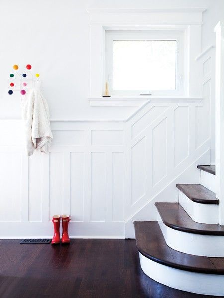 High-Contrast Foyer  red Hunters + Eames coat rack  via House & Home