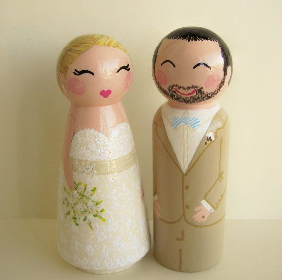 Hand painted wood peg dolls for a cake topper. That would be a cute and fun thing to do.