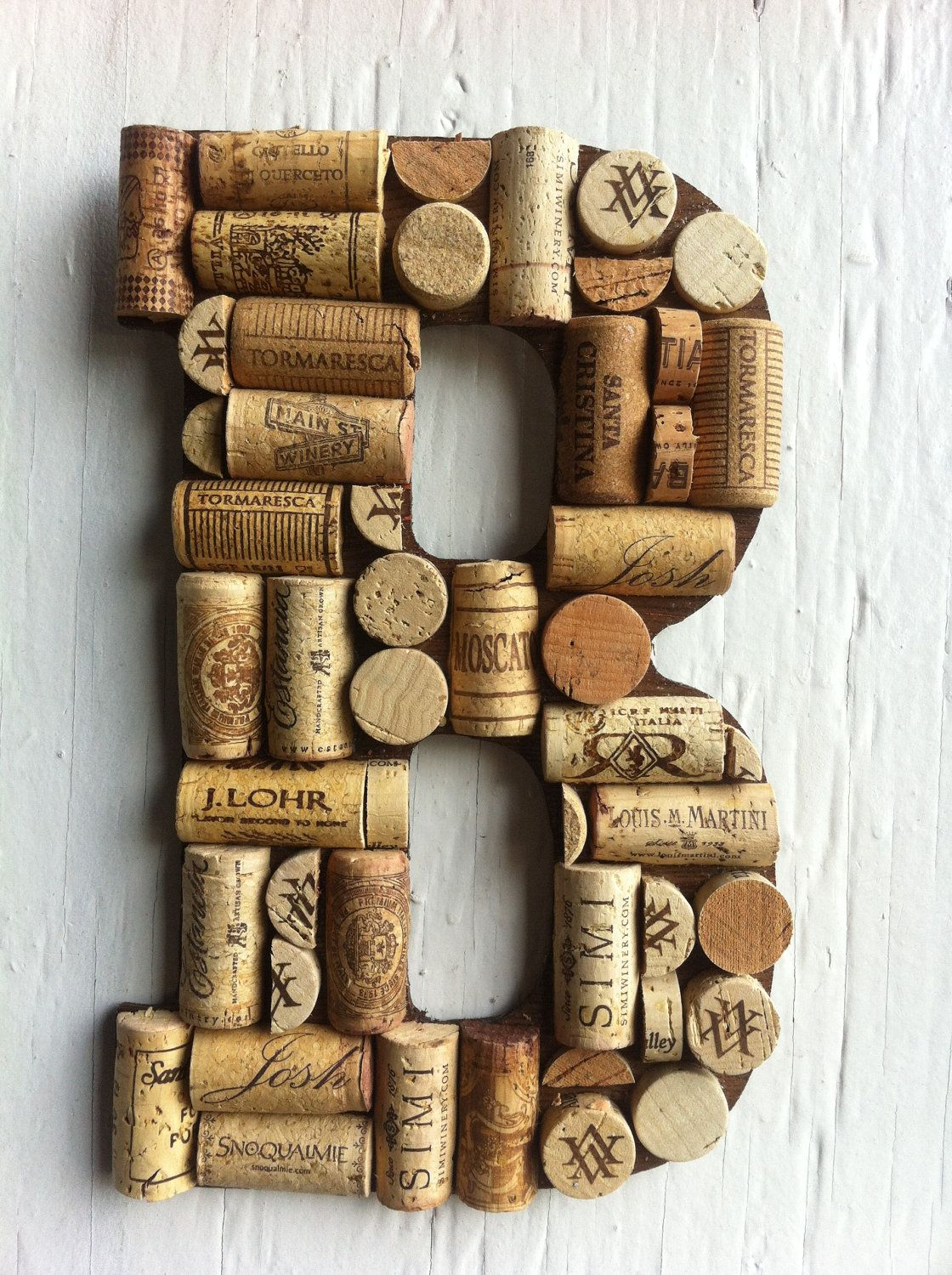 Handmade letters and symbols made of wine corks discover for Crafts with wine bottle corks