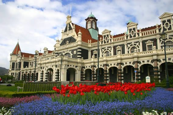 Dunedin Railway Station With Spring Flowers In Bloom By Maria Van