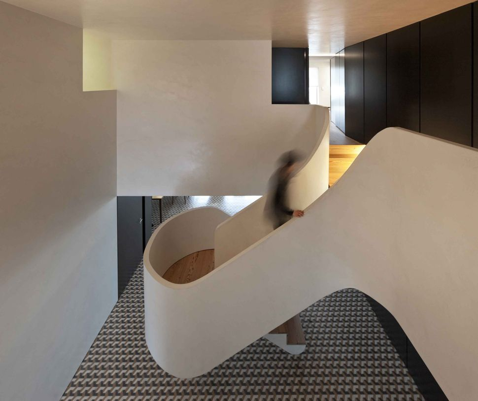 Minimalist Home Wows With Bold Flooring And Staircase Sculpture