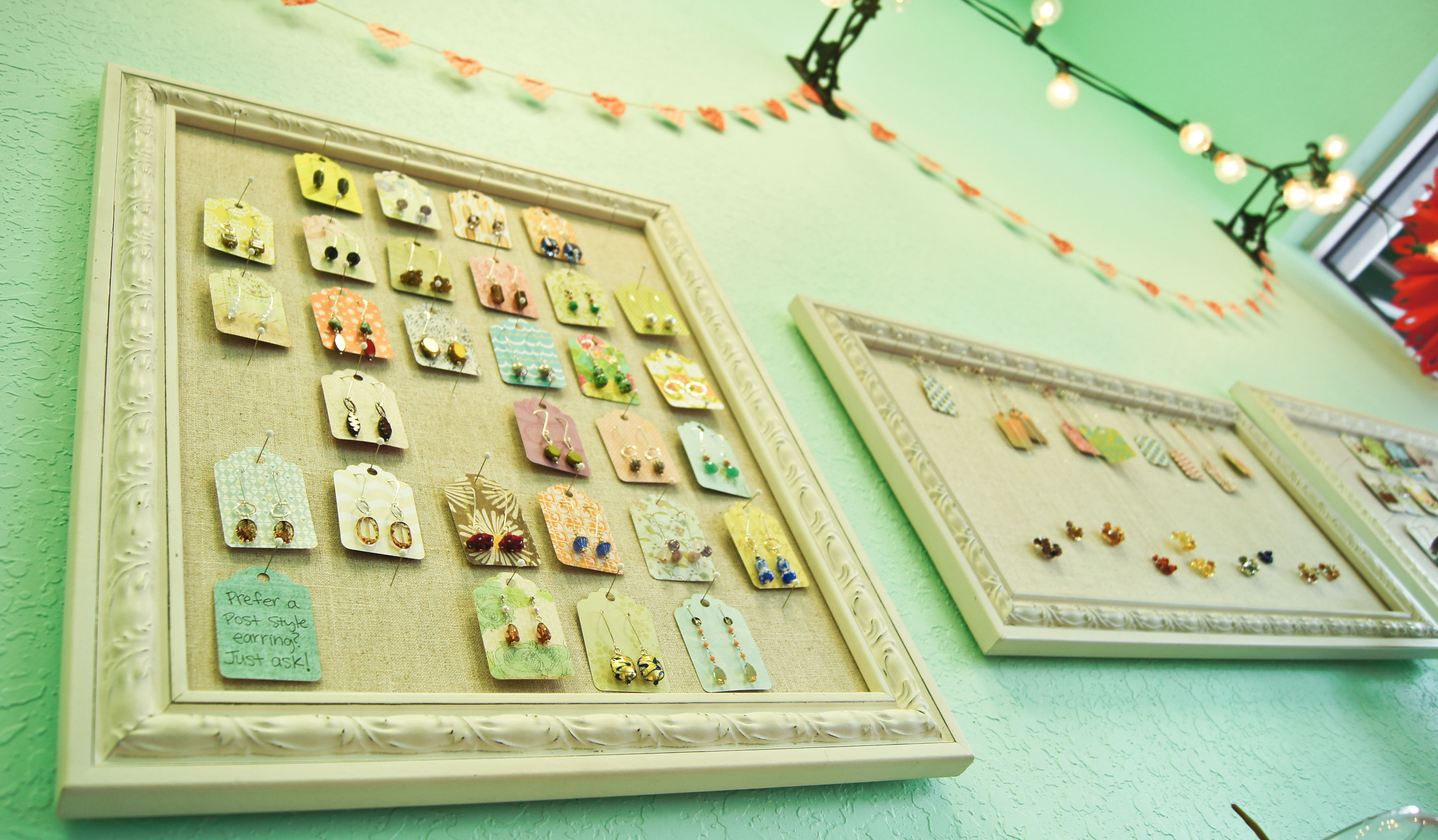 Jewelry display boards. Made these by covering foam core board in linen and fitting the boards into open frames! Customers often comment on how pretty they are!
