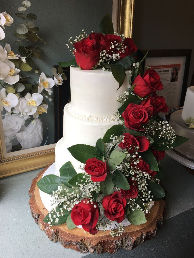 Add bold red roses touch to your wedding cake to give a