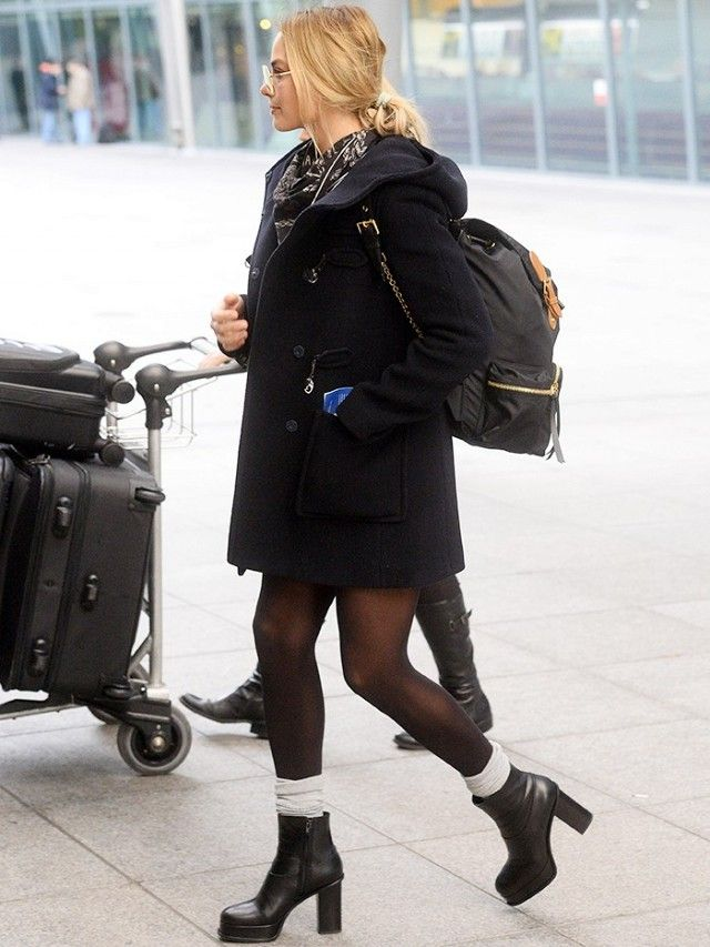 80325ededafbb Margot Robbie wears a mini dress, peacoat, scarf, tights, gray socks,  platform boots, and a Burberry backpack