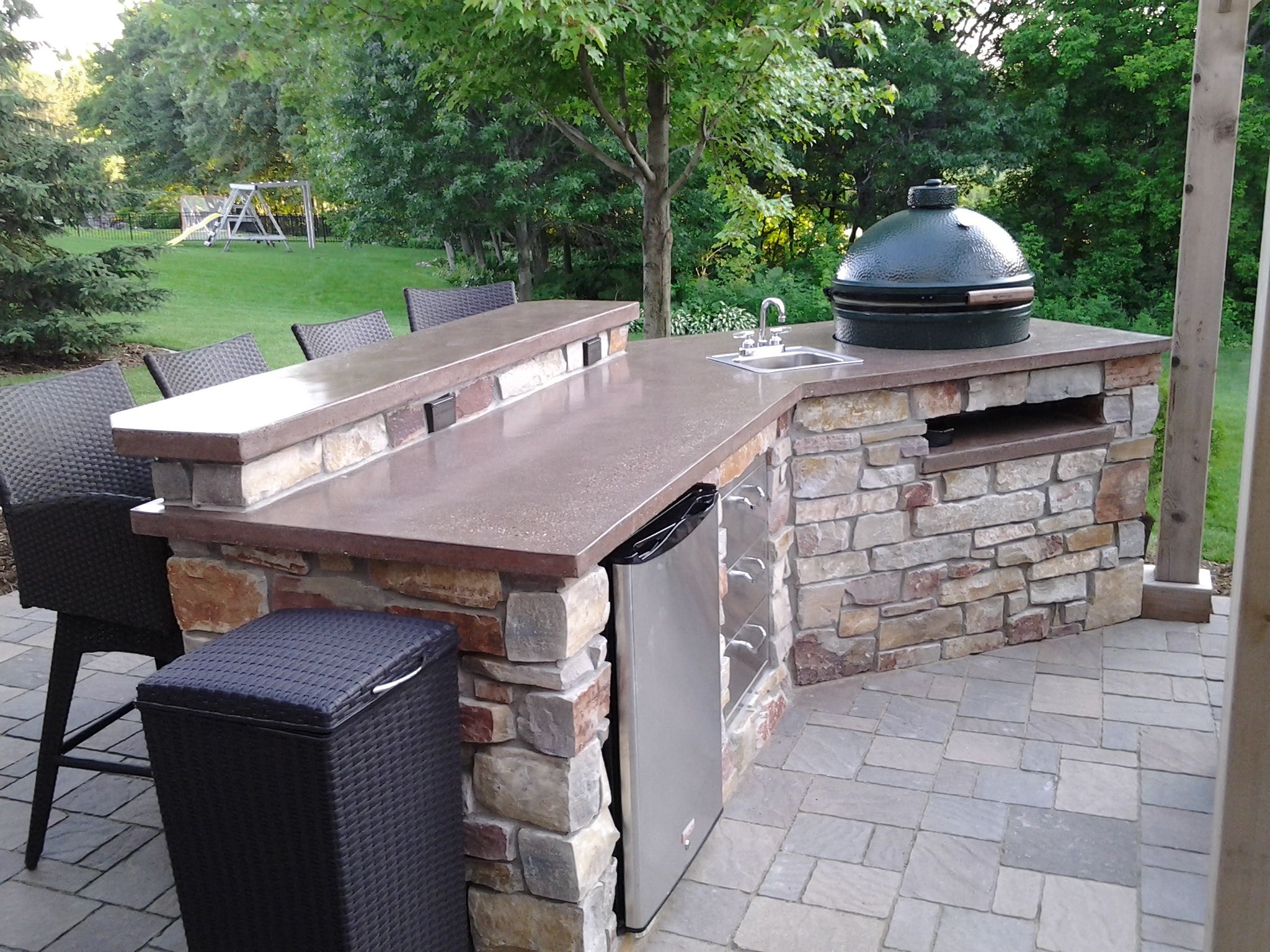 Outdoor Kitchen With Weathered Edge Natural Stone And Colored And