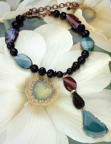 "This accessory is for the jewelry obsessed....    Faceted black quartz beads mixed with rough faceted natural multicolor agate slab beads will dazzle your neckline.  The necklace highlights the 5"" dro"