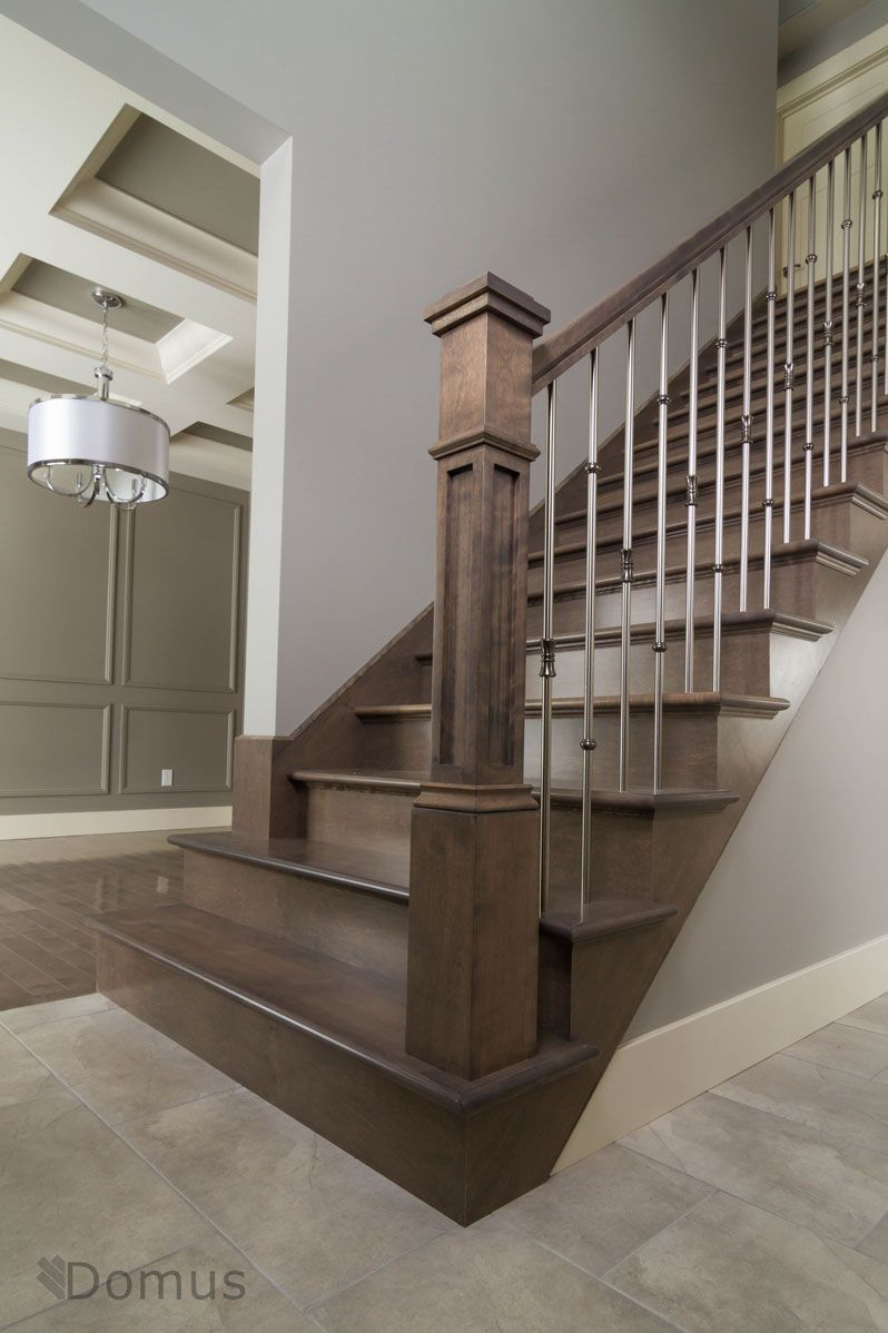 Dark Stained Staircase With Modern Stainless Spindles
