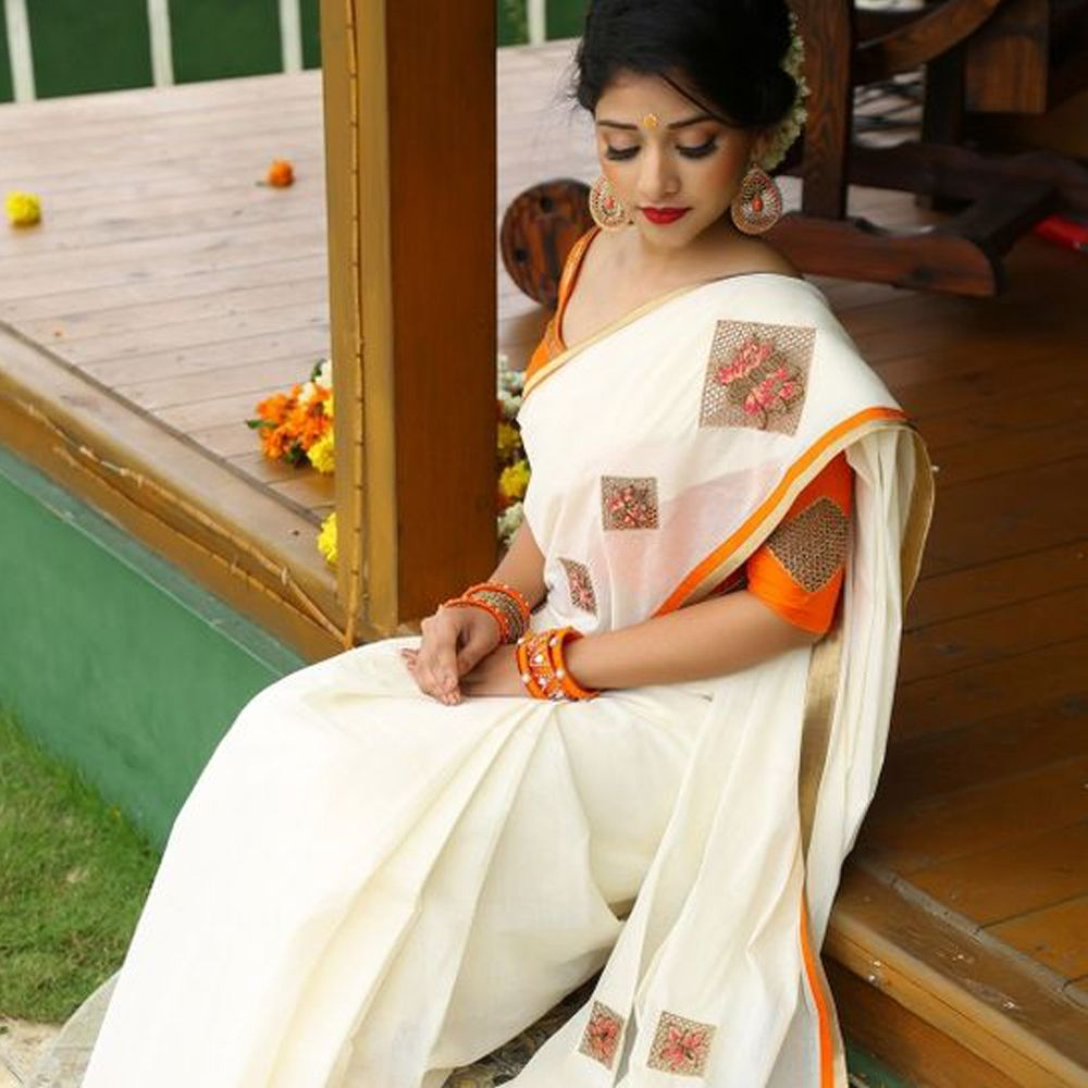 Wedding White Sarees Online: Buy This Latest White-Orange Colored Festive Wear