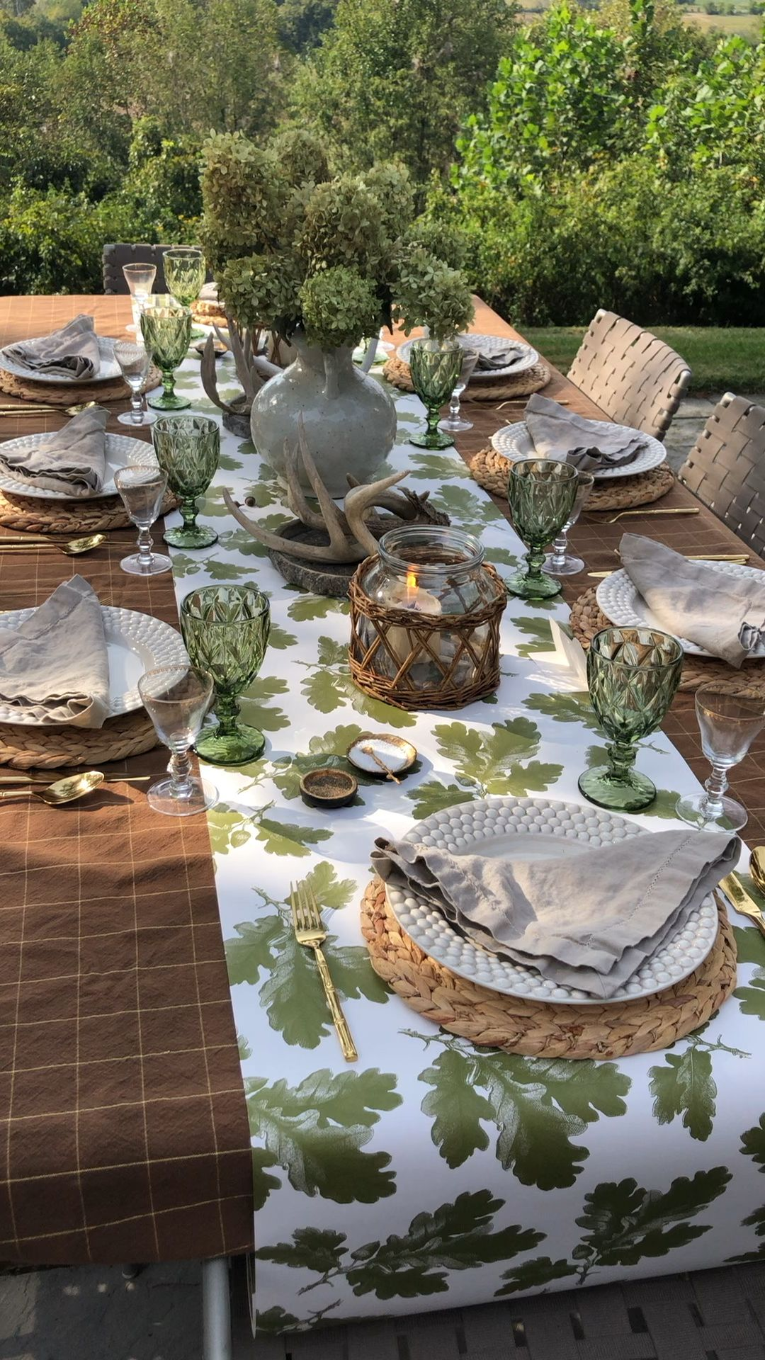 We are obsessed with this green and brown Tablescape utilizing our Fall Holiday Tablecloth, Oakleaf Runner, Green Goblets, Water Hyacinth Placemats, Ecru Napkins and Wicker Hurricanes. It's fresh and will take you thru fall with a effortless elegance that's easy and quick to set up.