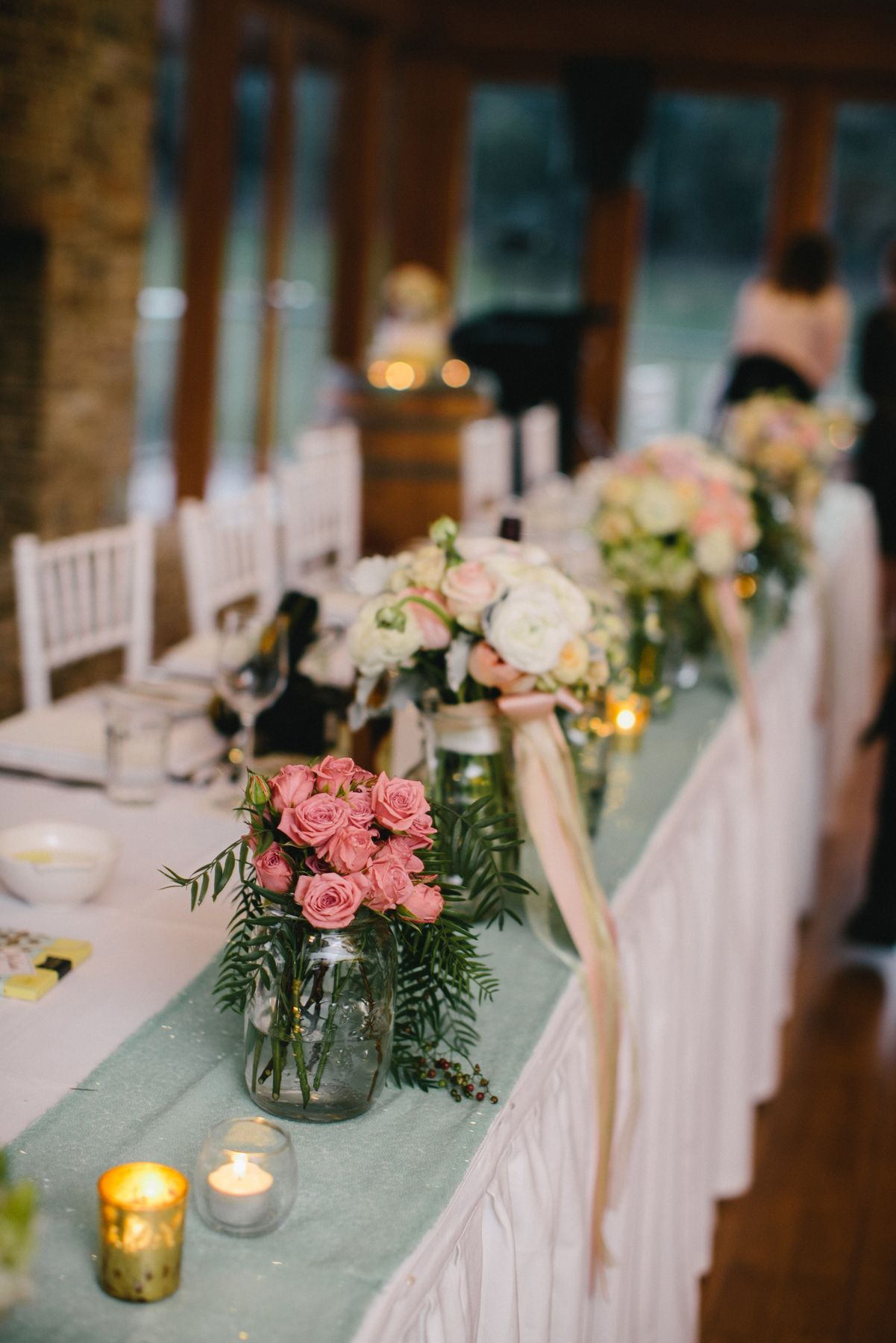 Mint Green Table Runner And Pastel Coloured Flowers Wedding