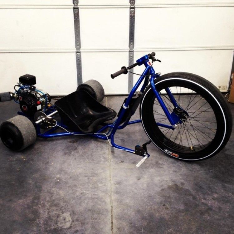 the trike is set in motion with a twist throttle fixed to the aluminum bars