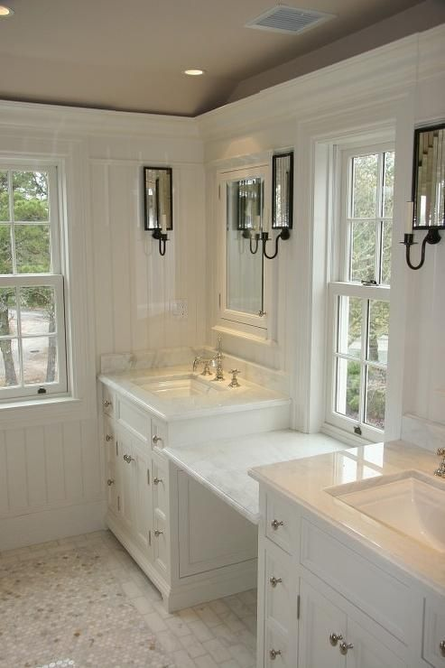 bathroom countertops, makeup station in the middle, tile, sconces