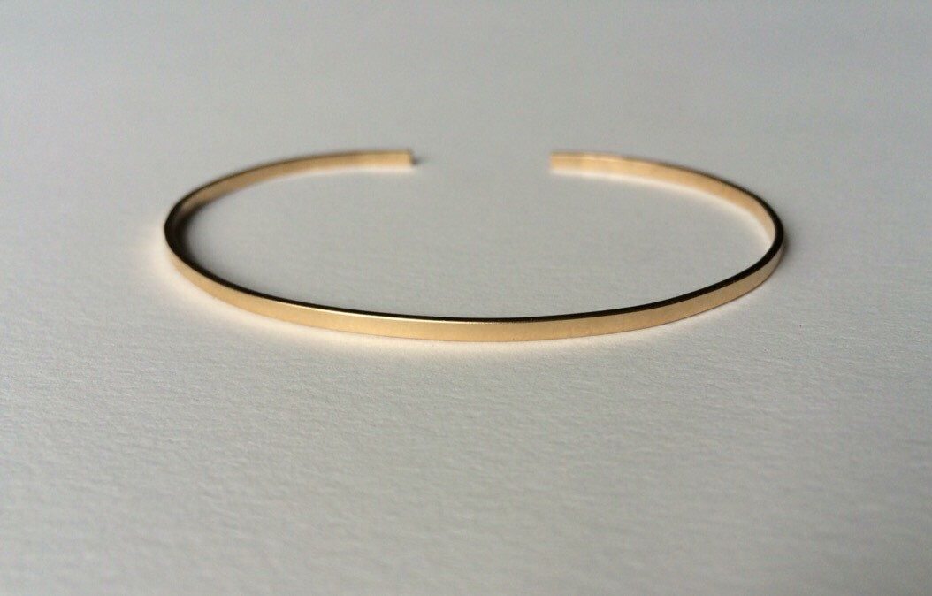 14k Gold Cuff Bracelet- Recycled Gold Cuff Bracelet- Thin Gold Bracelet- Eco Friendly Gold Cuff by MelissaTysonDesigns on Etsy https://www.etsy.com/listing/249592851/14k-gold-cuff-bracelet-recycled-gold