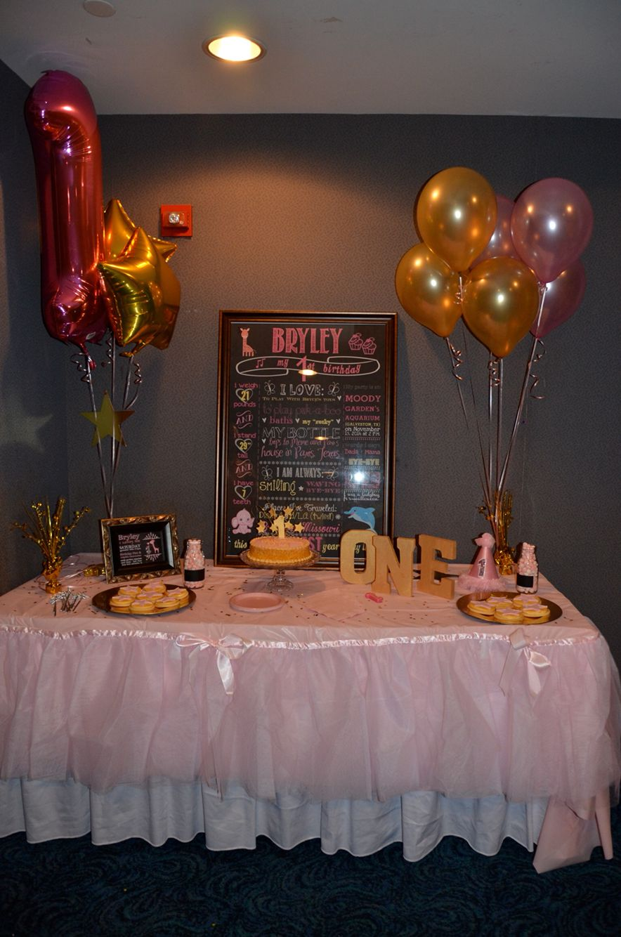 Baby girl's first birthday party table with Twinkle