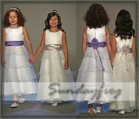ignore the flower girl... I don't love the type of flower they use, but the sash is pretty with the flower over the closure in the back