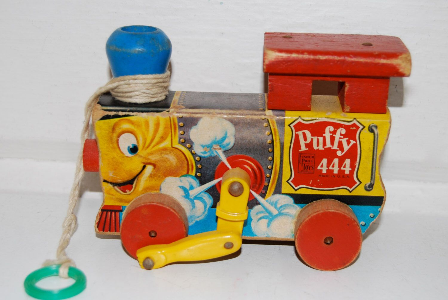 Vintage Fisher Price Puffy 444 Wooden Pull Toy by MilleBebe on Etsy https://www.etsy.com/listing/185355609/vintage-fisher-price-puffy-444-wooden