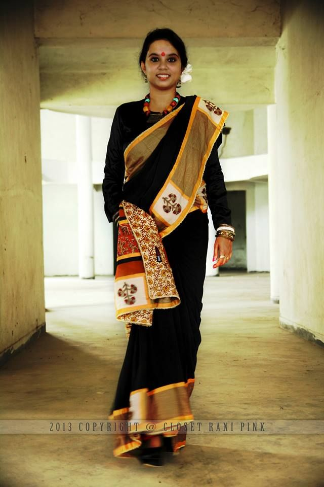 CR139209 - Kalam kari patch work saree with run stitch detailing on the border, Black color saree in pure georgette 80 grams, Border is in Bhagalpuri silk, Blouse in pure crepe border detail facing in floral block print orange color.