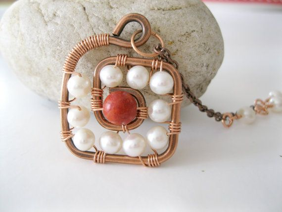Copper spiral wire wrapped with pearls and by PoppyJohalJewelry