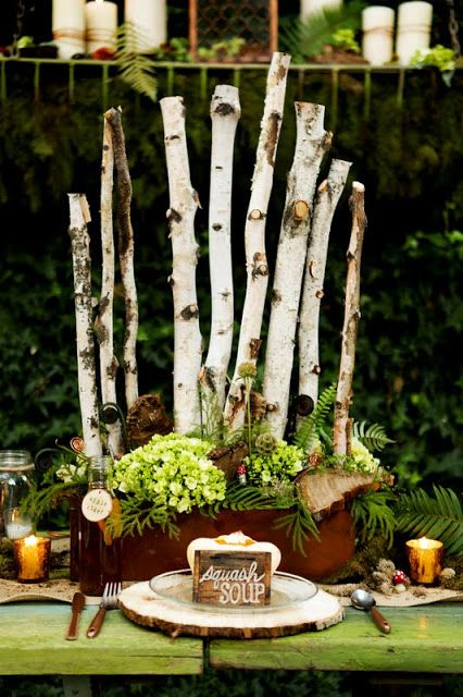 Birch pole moss and fern woodland wedding centerpiece by Branches Event Floral