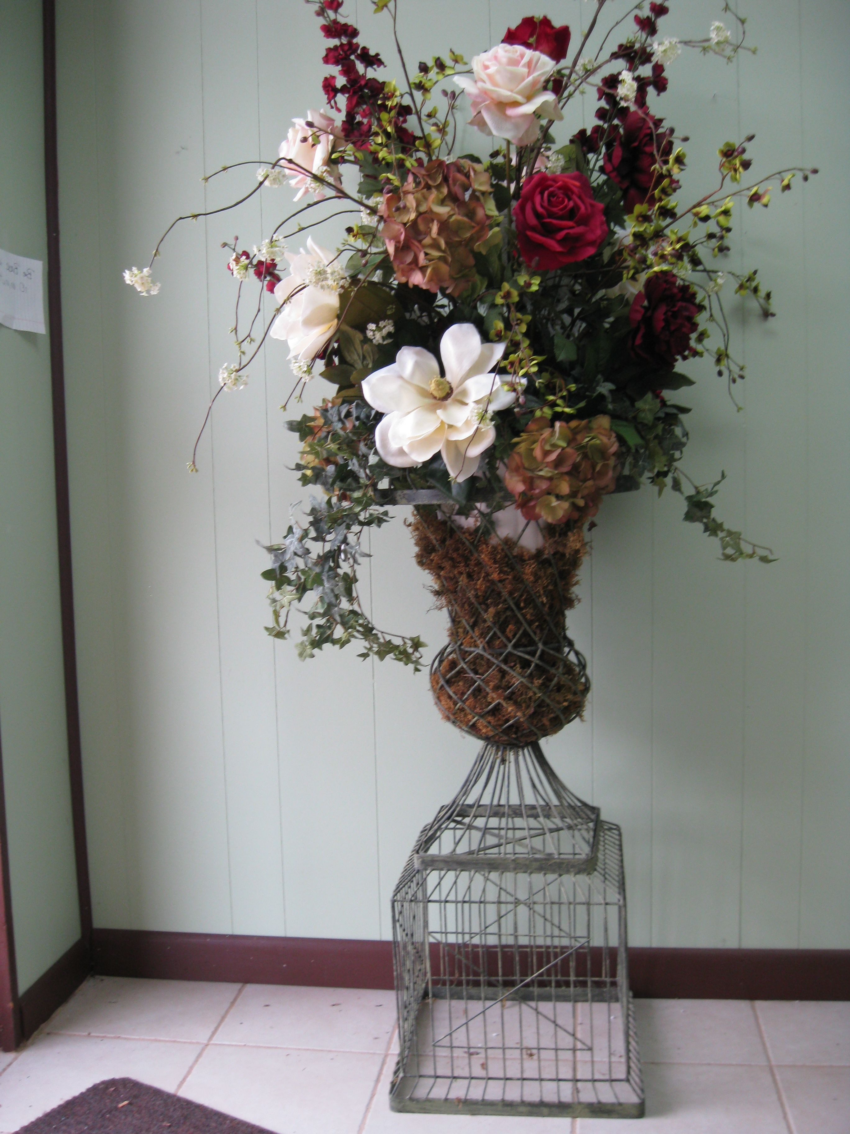 Decorating with fake flowers in urns arrangement in wire urn decorating with fake flowers in urns arrangement in wire urn flowers are artificial to give you a visual mightylinksfo