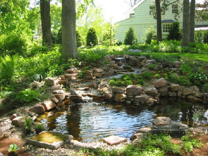 Small Pond With Boulders Decoration In Large Garden Green Area Water Features In The Garden Small Backyard Ponds Ponds For Small Gardens