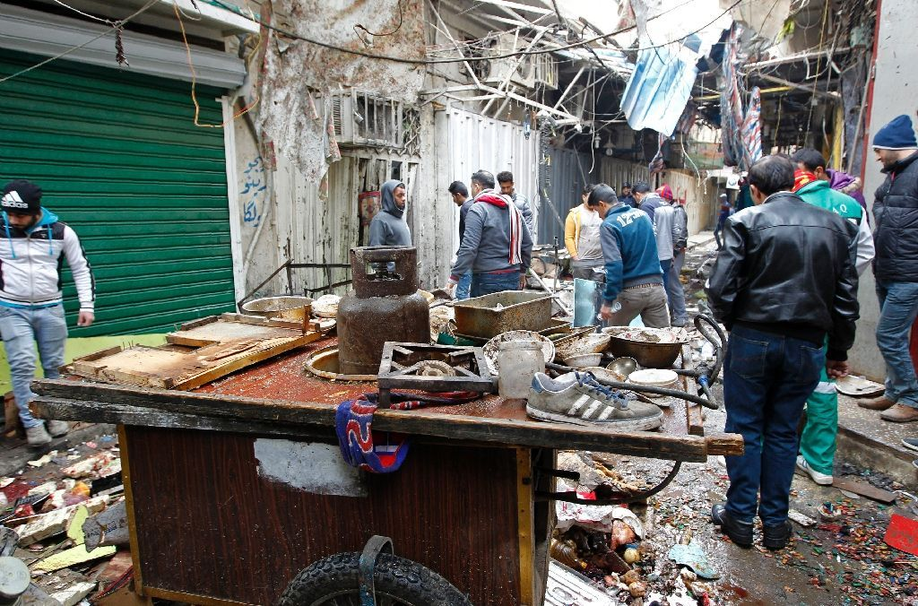 Twin blasts ripped through a busy market area in central Baghdad Saturday