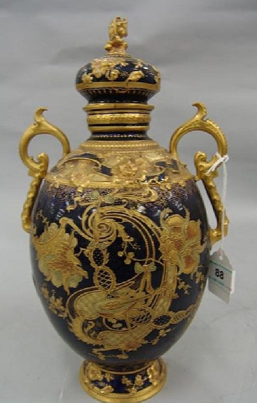 Royal Crown Derby porcelain ovoid covered urn with cobalt ground and gilt molded decoration