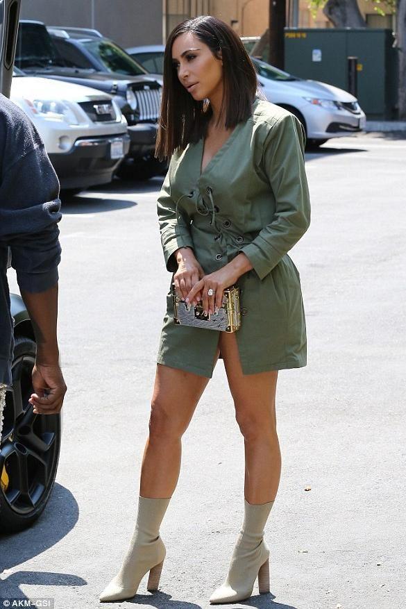 sale retailer 58ea3 5a632 Kim Kardashian wearing Yeezy Season 2 Knit Ankle Boot and Louis Vuitton  Petite Malle Bag
