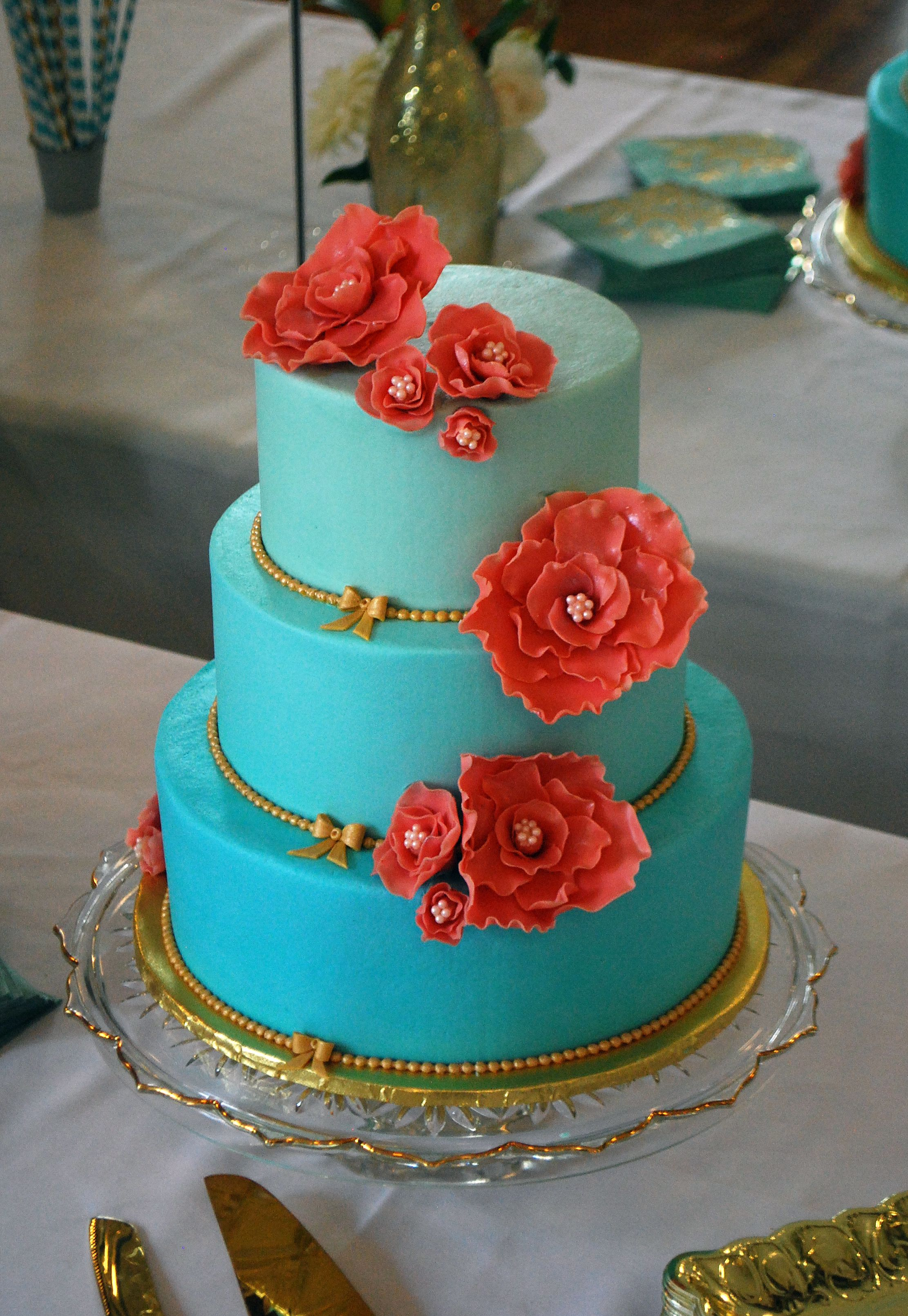 Bright Coral Gum Paste Flowers really pop against the ombre Tiffany ...