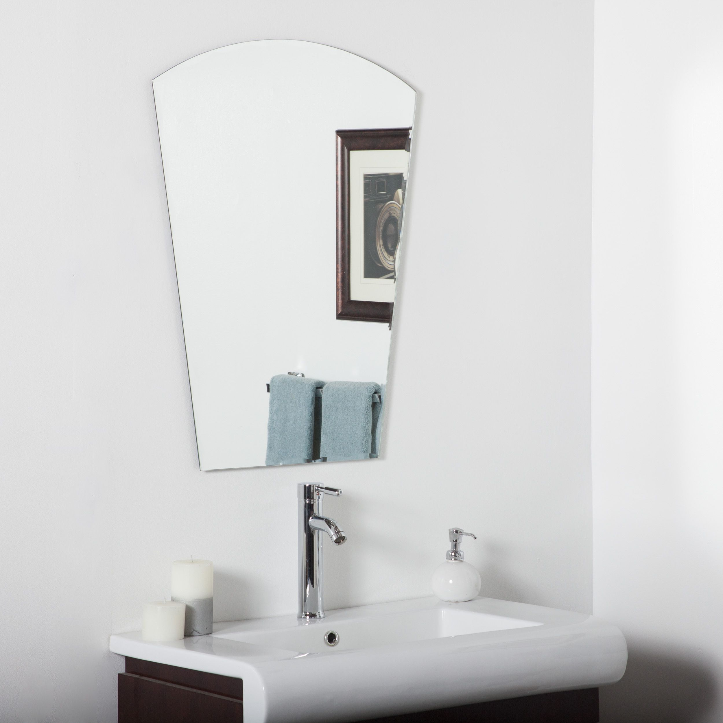 This large frameless bathroom mirror features a unique scallop bevel ...