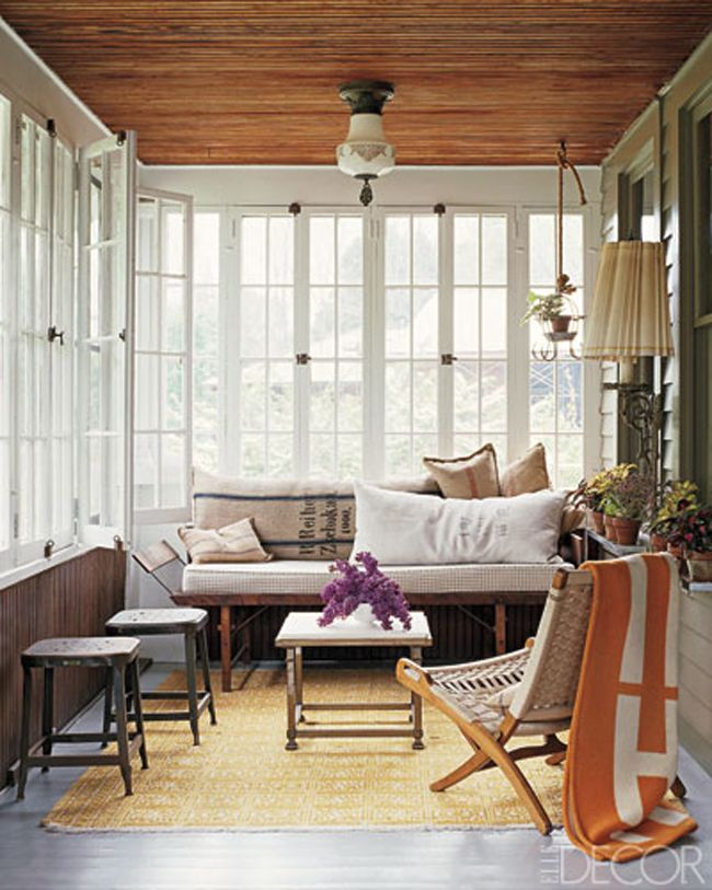 Stylish small sunroom design with wooden ceilings