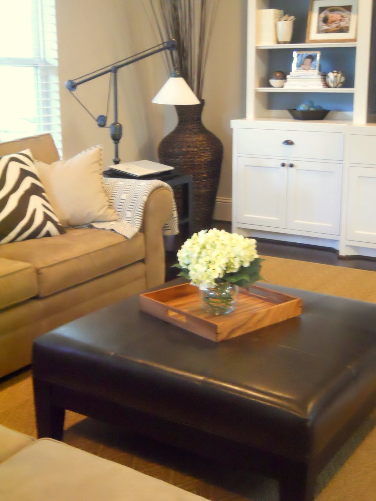 Living Room Ottoman Decor: Tan Couch With Zebra Pillow, Dark Leather
